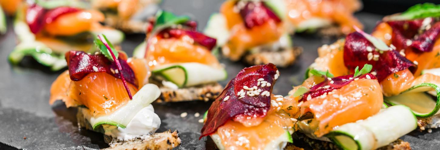 salmon appetizers on small pieces of toast